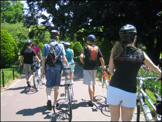 When the tour reaches Boston's Public Garden, the bikers dismount -- as the park does not allow bikers to ride through the garden.