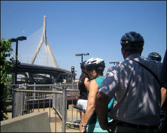 The bike tour allows riders to trek 'off the beaten path,' as the tour takes you across the Charles River locks along a walking and bike trail. This is one part of the tour that cars and trolleys cannot travel through. Riders Dianne and Chris Patterson (right) from Auckland, New Zealand, view the Zakim Bridge in the distance.
