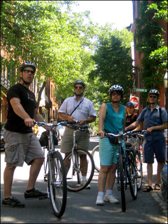 Prescott (left), Dianne and Chris Patterson (center), James Tinker of London (right), and tour guide Mike Maker (back), rest before heading up their final hill in Boston's Beacon Hill neighborhood. Bikers enjoy an intense ride up several of Beacon Hill's historic steep roads.