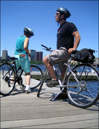 The tour's final stop is a dock along the Charles River. Bikers have a clear view across the river to Cambridge.