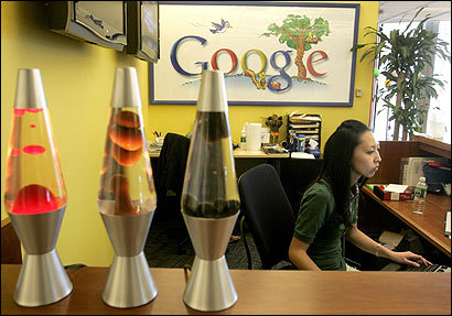 Amid lava lamps and the company's familiar bright colors, Elizabeth Lo worked this week at the front desk of Google Inc. at One Broadway in Cambridge