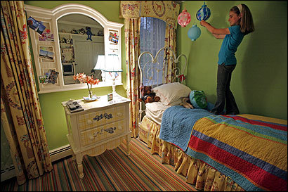 Marjorie Burke, 11, turns on the Japanese lanterns in her bedroom in Dedham.