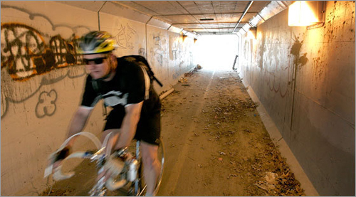 A bicyclist speeds through the tunnel in Eastham.