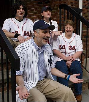 Yankees diehard Ron Czik with his son, Josh, daughter Shoshana, and wife, Wendy, all of them Red Sox fans, at their Sharon home yesterday. His family will watch this weekend's series in the family room; he'll be in the basement.