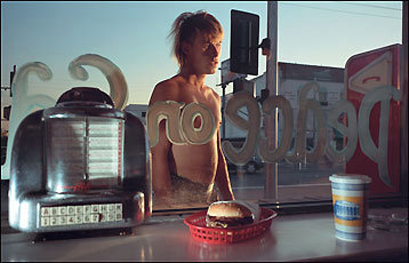 Some 120 of Philip-Lorca diCorcia's photographs make up a rich retrospective at the Institute of Contemporary Art. In 'Eddie Anderson; 21 years old; Houston, Texas; $20,' the subject is in the background, visible through the window of a coffee shop.