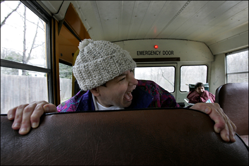 Jean Hanlon (left) and her twin sister, Joan, both 49, and other mentally handicapped residents of her cottage took a bus trip to nowhere -- just for the ride. Jean and Joan have been living at Fernald Development Center in Waltham, the nation's oldest institution for the mentally retarded, since they were toddlers.