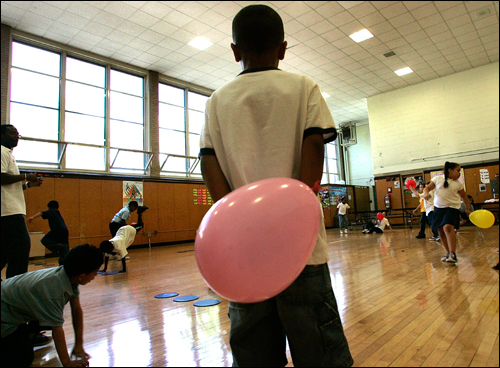A first-grader participated with his classmates in a balloon volleyball session during gym class at the John F. Kennedy Elementary School in Jamaica Plain on Tuesday, May 29.