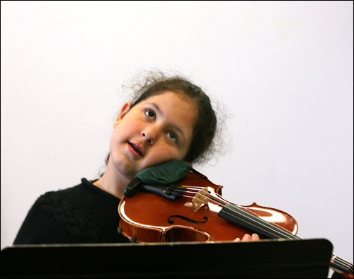 Maria Garcia, 11, paused during a semi-private violin lesson on Thursday, May 10, at the Conservatory Lab Charter School.