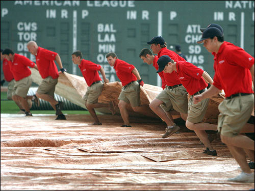 The Red Sox ground crew pulled the tarp over the infield at the start of the rain delay. The delay pushed the start of the game back to 7:30 p.m..