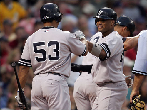 Yankees second baseman Robinson Cano (right) celebrated at home plate with teammate Bobby Abreu (53) after Cano's two-run home run in the second inning.