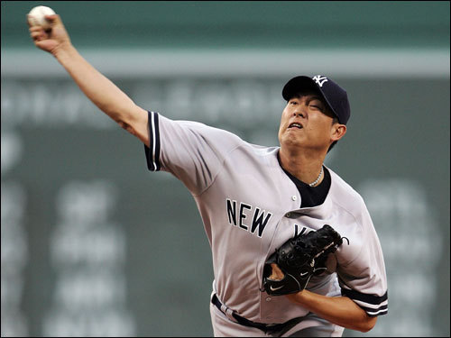 Yankees starter Chien-Ming Wang delivered a pitch in the first inning.