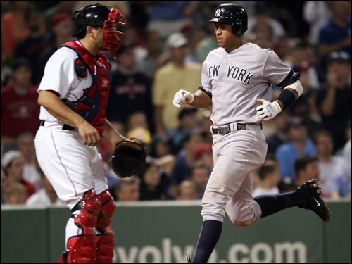 Alex Rodriguez (right) scored on a hit by Jorge Posada (not pictured) in the fourth inning.