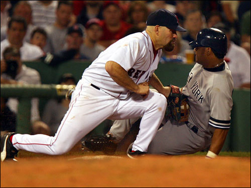 Red Sox third baseman Kevin Youkilis tagged out Bobby Abreu attempting to steal in the fifth inning.