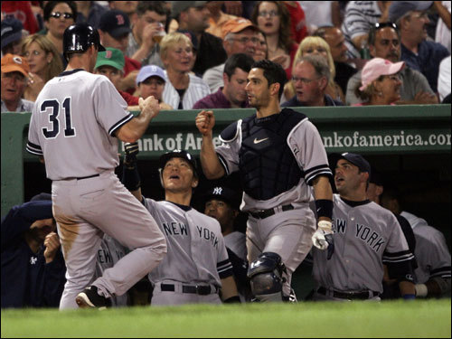 Josh Phelps was congratulated by teammates Hideki Matsui (55) and Jorge Posada (20) after Phelps stole home in the fourth.