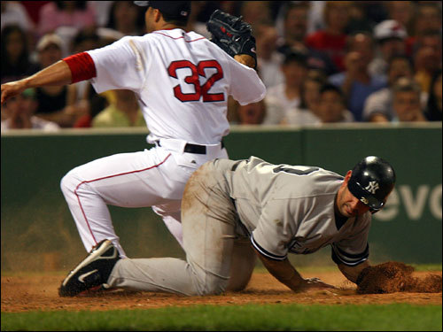 Red Sox reliever J.C. Romero (left) tagged out Jorge Posada (right) at home plate in the sixth inning.