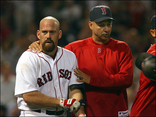 Red Sox manager Terry Francona (right) calmed down Kevin Youkilis as he walked him back to the dugout.