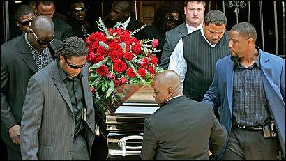Teammates, former teammates and friends carry the casket containing the body of former Patriot Marquise Hill following funeral services at the Greater St. Stephen's Full Gospel Baptist Church in New Orleans.