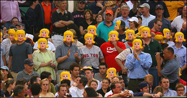 Dozens of fans wore the blonde masks to remind Rodriguez of his reported recent visit to a Toronto gentleman's club.