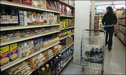 A shopper at the Bethlehem Village Store perused an aisle containing kosher products.