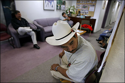 Orbelio Ayala and others held in the New Bedford immigration raid waited at Greater Boston Legal Services for assistance with their cases.