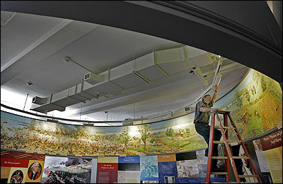 Neal Mayer, designer of the exhibit at the new Bunker Hill Museum, worked on lighting yesterday in preparatio