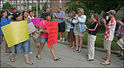 On day three of their strike, Quincy High School teachers applaud students who showed up to support them yesterday.