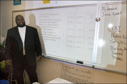 Vaughn, shown here speaking to a high school statistics class, said his work isn't about feeling guilty for only playing two injury-plagued, subpar seasons in New York before retiring in January 2004. ''I got paid for what I had done,'' said Vaughn, who was making $15 million a year. ''In baseball that's how they do things. I didn't owe anybody anything. ... I end up in New York and create a business that my idol was involved with. There's nothing here to be sorry about.''