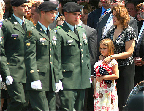 A funeral was held Friday for US Army Private First Class Matthew Bean, 22, of Pembroke, who was killed in Iraq by a sniper's bullet. At left, his mother, Mary Brennan, and Bean's sister, Molly, 6, stood after the service at North River Community Church while Army pallbearers walked past.
