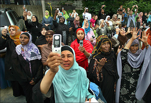 Thousands of area Muslims looked upward as the copper cap was put in place, some with tears running down their cheeks.