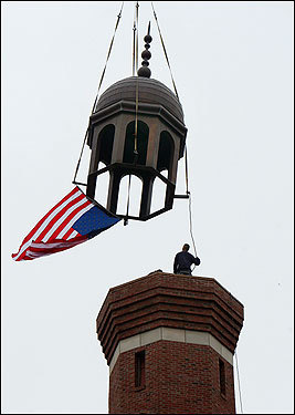 After a daylong celebration Saturday at the new Islamic Society of Boston's Cultural Center and Mosque in Roxbury, workers lowered the 5,000-pound copper cap onto the 140-foot high tower.
