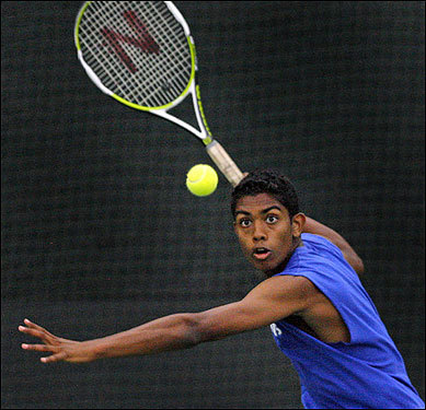 Acton-Boxboro's number one singles player Surainder Asokaraj eyed a return during his tennis match Sunday against Concord-Carlisle's Ari Zyskind (not pictured).