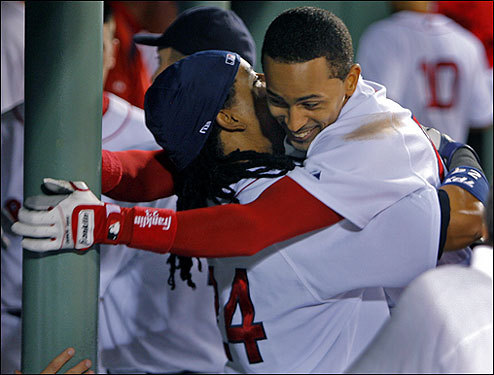Manny Ramirez (left) hugged Julio Lugo Tuesday after J.D. Drew's bases-loaded sacrifice fly gave the Red Sox a 2-1 win over the Colorado Rockies in Fenway Park.