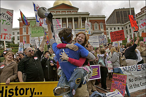 The Massachusetts Legislature, in a vote as swift as it was historic, reaffirmed the state's first-in-the-nation same-sex marriage ruling Thursday, unequivocally protecting the rights of gays and lesbians to wed in Massachusetts until at least 2012. At left, Erin Dunn is hugged after hearing the results of the vote at the State House in Boston.