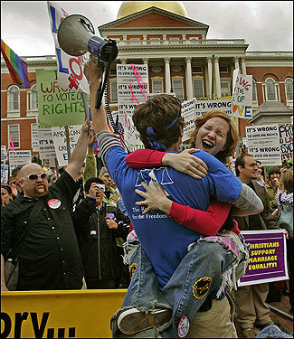 Erin Dunn was hugged outside the State House after hearing the results of the vote.