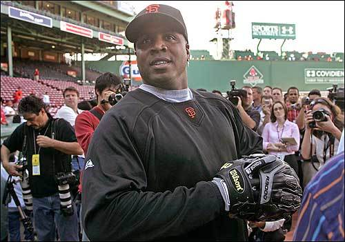 Controversial Giants slugger Barry Bonds smiled amid heavy media coverage as he stepped on to the field at Fenway Park Friday evening. It marked the first time he played in Boston in his career.