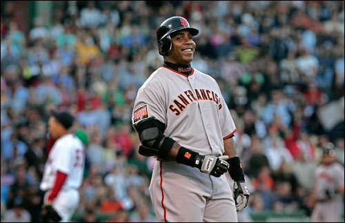 A laughing Barry Bonds pulled up short of first base after his blast to right field was ruled just foul in the first inning.