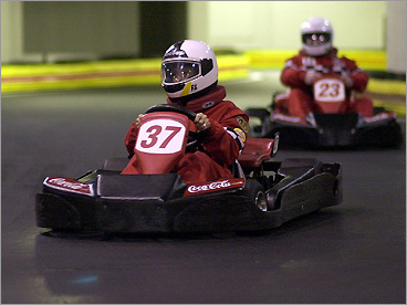Racing karts come out of a tunnel at F1 in Braintree