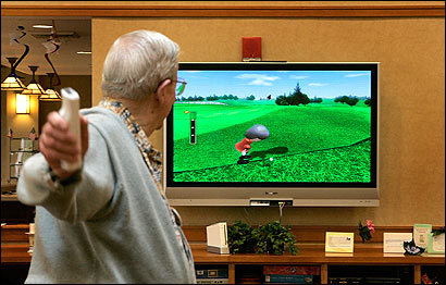 Bob Pearson hits the virtual links at the Linden Ponds retirement community in Hingham.