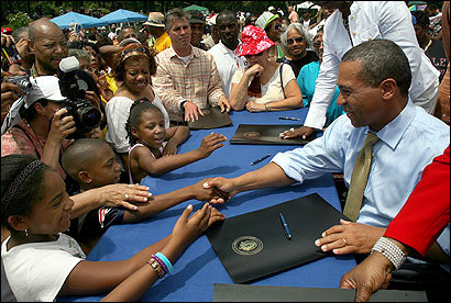 Governor Deval Patrick shook hands with children after signing a proclamation on Juneteenth in Dorchester yesterday. Massachusetts &lt;br /
