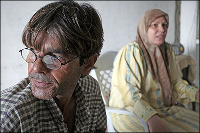 Hamdullah Hassouneh longed for a better life. Instead he and his wife Wasfiyeh (right) have mounting debts.