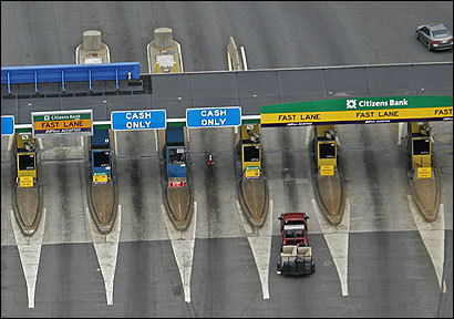 The proposed expansion of express lanes on the turnpike would allow vehicles with special transponders to go through tollbooths without slowing down.