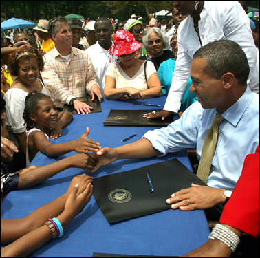 During the Roxbury Homecoming Day at Franklin Park, Governor Deval Patrick shook hands with children who made their way to the front, after he signed a proclamation making Juneteenth Day official in Massachusetts.