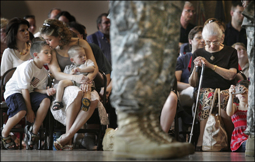 Sarah Romano comforted her son Andrew (left) and her nephew Antonio during a deployment ceremony at the Massachusetts National Guard Museum for some 30 Guard members, including Sarah's husband Captain Joshua Romano.