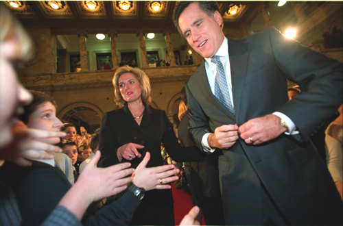 "On his first day at the State House as governor, Mitt Romney, with his wife, Ann, proceed to the House Chamber where, in his televised inaugural address, Romney declared: ""We are facing a financial emergency … There is no easy way out of this mess.'"