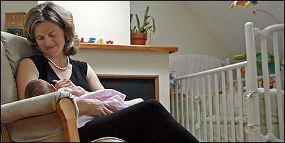 Sophie Currier with her daughter, 7-week-old L&#233;a, at home in Brookline.