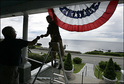 Nick Pelletier (on ladder) helped Kennebunkport, Maine, inn owner Jack Nahil hang a banner in anticipation of Russian President Putin's arrival next Sunday.
