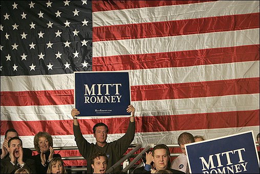 Romney supporters held up signs at the Iowa State Fairgrounds following his announcement in Michigan.