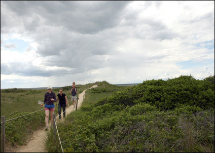 A family enjoys a scenic walk in the Cedar Tree Neck Nature Preserve in West Tisbury. Frommer's picks: Attractions, restaurants, lodging