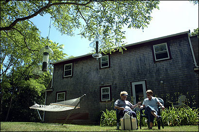 Linda Hubley and her daughter, Barbara, relaxed in the yard of Barbara's Eastham house. Barbara Hubley and the house's co-owner, Nancei Radicchi, still have weeks available to rent.