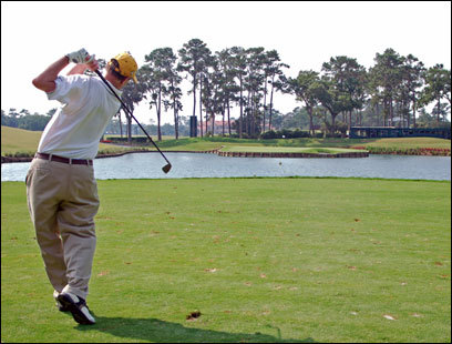 The author watches his tee shot on the 17th hole at TPC Sawgrass in Ponte Vedra Beach, Fla.
